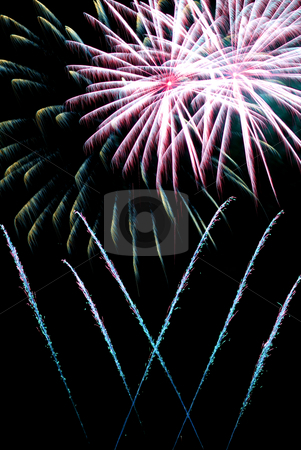 Fireworks in the night sky stock photo, Colorful fireworks in the night dark sky. by Homydesign 