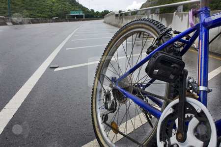 Mountain bicycle at sunny day  stock photo, Mountain bicycle on highway at sunny day by Keng po Leung
