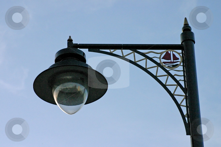 Ornate Street Light Against Blue Sky stock photo, Ironwork Street Lamp by Chris Green