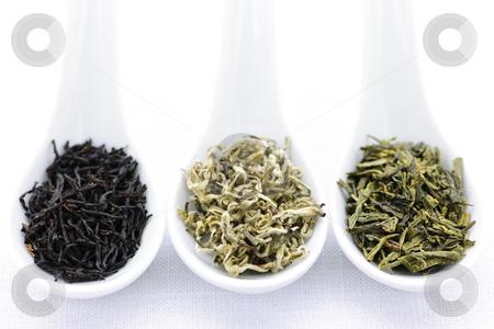 Assortment of dry tea leaves in spoons stock photo, Black, white and green dry tea leaves in spoons by Elena Elisseeva