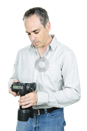 Photographer with camera stock photo, Photographer reviewing photos on DSLR camera isolated on white background by Elena Elisseeva