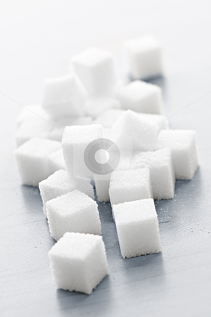 Sugar cubes stock photo, Close up of many white sugar cubes by Elena Elisseeva