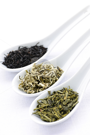 Assortment of dry tea leaves in spoons stock photo, Black, white and green dry tea leaves in spoons by Elena Elisseeva