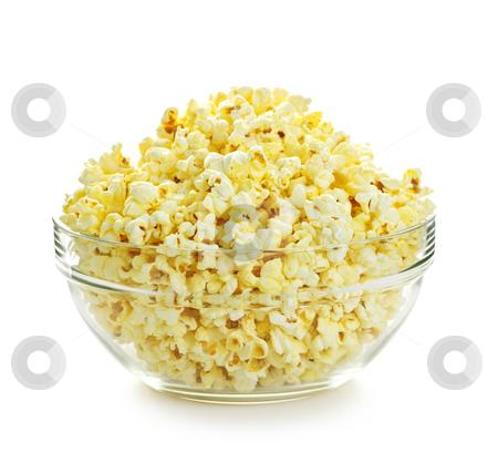Bowl of popcorn stock photo, Bowl of fresh popped popcorn isolated on white background by Elena Elisseeva