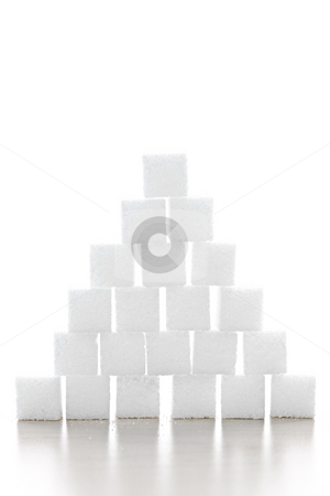 Sugar cube pyramid stock photo, Pyramid of white sugar cubes stacked up on white background by Elena Elisseeva