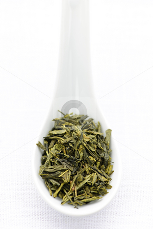 Dry green tea leaves in a spoon stock photo, Green dry tea leaves on a spoon by Elena Elisseeva