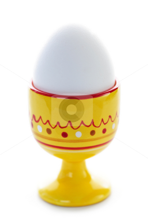 Boiled egg in cup stock photo, Closeup of soft boiled egg in cup isolated on white by Elena Elisseeva