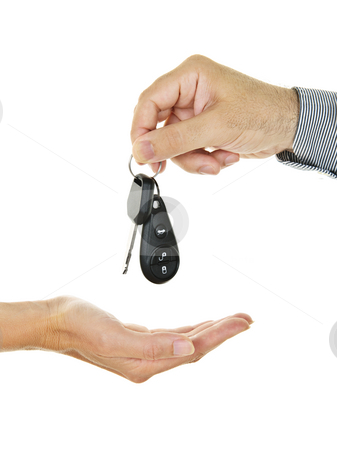 Giving car key stock photo, Male hand giving car key to female hand by Elena Elisseeva