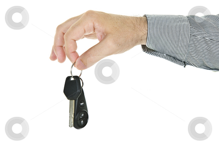 Hand holding car key stock photo, Hand holding car key and remote entry fob isolated on white background by Elena Elisseeva