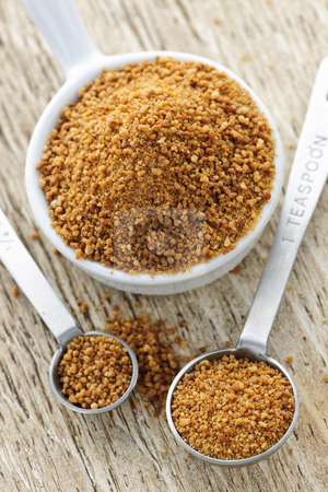 Coconut palm sugar in measuring spoons stock photo, Organic coconut palm sugar in measuring spoons by Elena Elisseeva