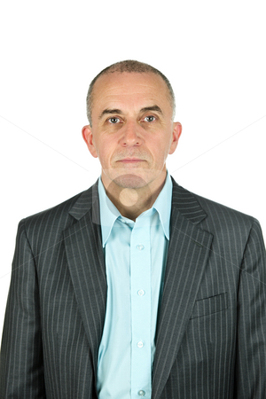 Businessman on white background stock photo, Portrait of serious businessman isolated on white background by Elena Elisseeva