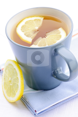 Tea with lemon stock photo, Cup of fresh hot tea with lemon slices by Elena Elisseeva