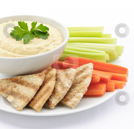 Hummus with pita bread and vegetables stock photo, Healthy snack of hummus dip with pita bread slices and vegetables by Elena Elisseeva