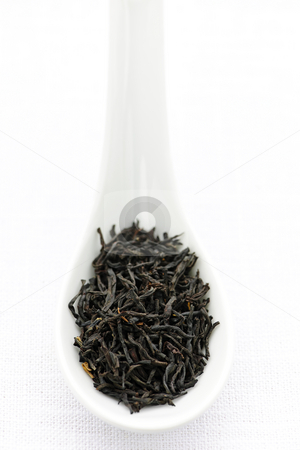 Dry black tea leaves in a spoon stock photo, Black dry tea leaves on a spoon by Elena Elisseeva