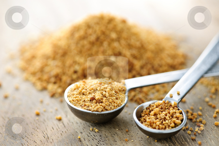 Coconut palm sugar in measuring spoons stock photo, Organic coconut palm sugar in measuring spoons by Elena Elisseeva