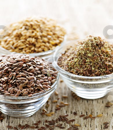 Brown and golden flax seed stock photo, Bowls of whole and ground flax seed or linseed by Elena Elisseeva