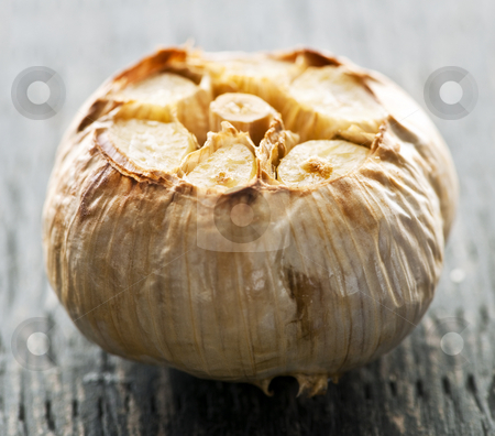 Roasted garlic bulb stock photo, Close up of fresh roasted garlic bulb by Elena Elisseeva