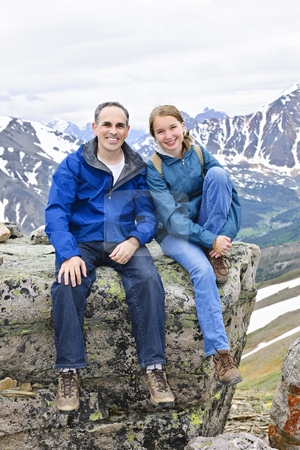 Father and daughter in mountains stock photo, Father and daughter enjoying scenic Canadian Rocky Mountains view in Jasper National park by Elena Elisseeva