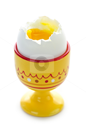 Soft boiled egg in cup stock photo, Closeup of soft boiled egg in cup isolated on white background by Elena Elisseeva