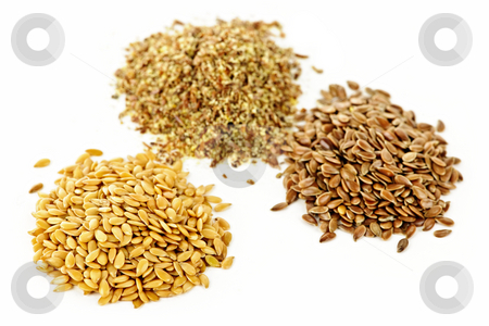 Brown, golden and ground flax seed stock photo, Heaps of brown, golden and ground flax seed or linseed isolated on white background by Elena Elisseeva