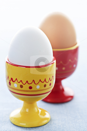 Boiled eggs in cups stock photo, Closeup of two soft boiled eggs in cups by Elena Elisseeva