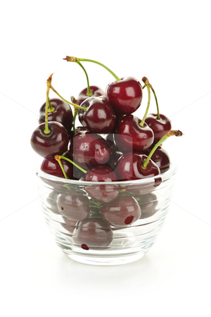 Bowl of cherries stock photo, Fresh cherries in glass bowl on white background by Elena Elisseeva