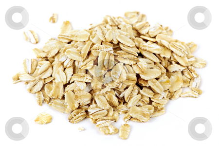 Pile of uncooked rolled oats stock photo, Heap of dry rolled oats isolated on white background by Elena Elisseeva