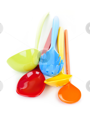 Kitchen utensils stock photo, Various colorful plastic kitchen utensils on white background by Elena Elisseeva