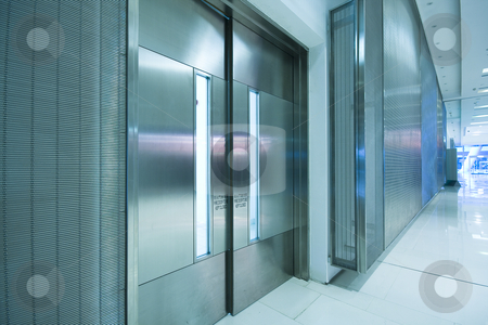 big steel door in office building with long corridor  stock photo, big steel door in office building with long corridor . by Keng po Leung