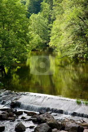 Water weir  stock photo, Calm river in the Black Forest plashes over a weir by Herb Allgaier