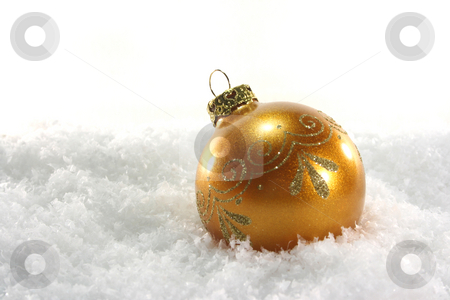 Christmas ball stock photo, One golden Christmas ball lies in the snow by Marén Wischnewski