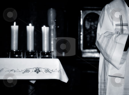 Mass stock photo, Catholic Priest and the  altar during  Mass , black and white photo by Gordan Poropat