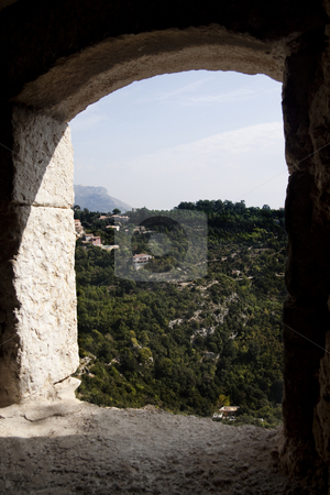 Archway View stock photo, A view of the mountains through a stone archway by Kevin Tietz