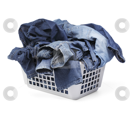 Jeans stock photo, A Laundy basket filled with only jeans. Isolated on white with natural shadows. by Stocksnapper