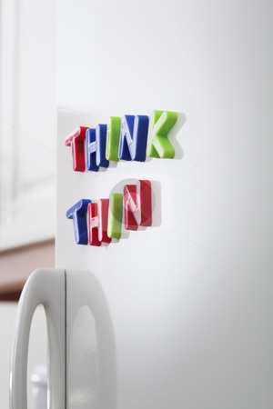 Think Thin stock photo, Words THINK THIN magnets on a refrigerator door by Stocksnapper 