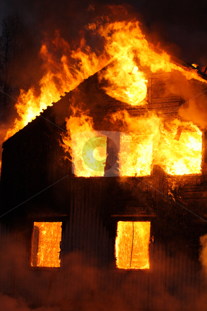 Burning house stock photo, An old Wooden house burning by Stocksnapper