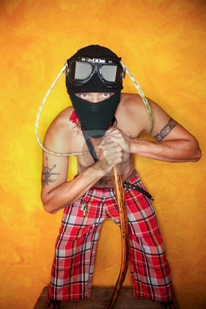 Strange Man stock photo, Strange man with knit mask and plaid pants by Scott Griessel