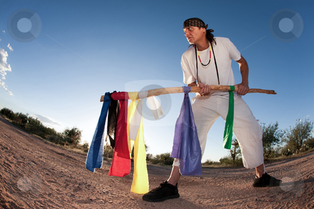 Native American man with colorful flags stock photo, Native American man with colorful flags representing seven directions by Scott Griessel