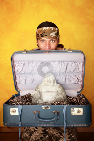 Man with Buddha in suitcase stock photo, Native American man with Buddha in a suitcase by Scott Griessel