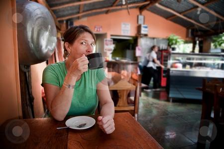 Woman in a Costa Rican cafe stock photo, Pretty adult woman in a Costa Rican cafe by Scott Griessel