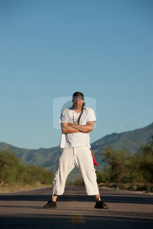 Man in the middle of a road stock photo, Native American man in the middle of a road by Scott Griessel