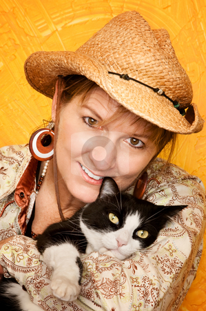 Pretty Western Woman with cat stock photo, Pretty western woman in cowbot hat with by Scott Griessel