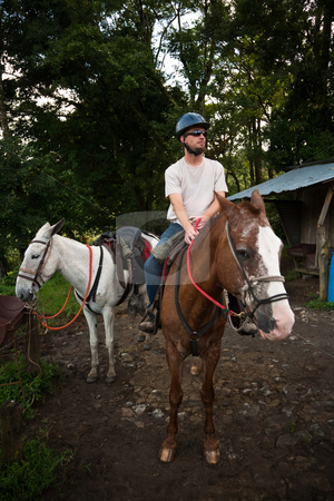 European or American man on horseback in Costa Rica stock photo, Handsome European or American man on horseback in Costa Rica by Scott Griessel