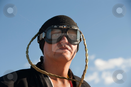 Man with knit cap and goggles stock photo, Man with knit cap, goggles and headdress by Scott Griessel