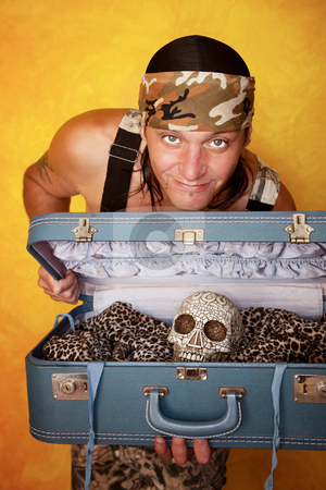 Man with skull in suitcase stock photo, Native American man with ornate skull in a suitcase by Scott Griessel