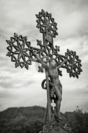 Old Cross stock photo, Old cross against the sky , black and white toned photo by Gordan Poropat