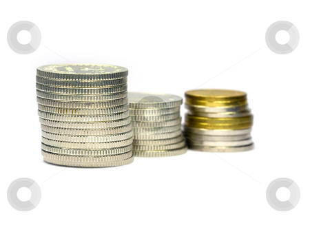 Stack of coins stock photo, Stack of coins on white background by GPimages