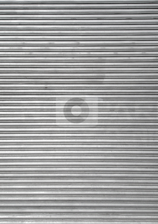 Metal warehouse door security shutters. stock photo, Metal warehouse door security shutters. by Stephen Rees