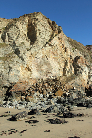 Large eroding cliffs in Porthtowan with fallen rocks. stock photo, Large eroding cliffs in Porthtowan with fallen rocks. by Stephen Rees