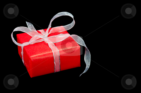 Red and Silver Xmas Gift Box on Black stock photo, Single red and silver Xmas gift box on a black background by Timothy Hodgkinson